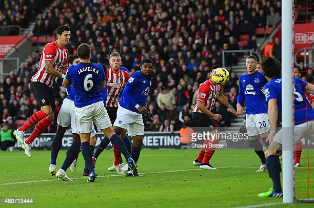 Jose Fonte of Southampton heads towards goal and his effort is deflected in by Romelu Lukaku of Everton during the Barclays Premier League match...