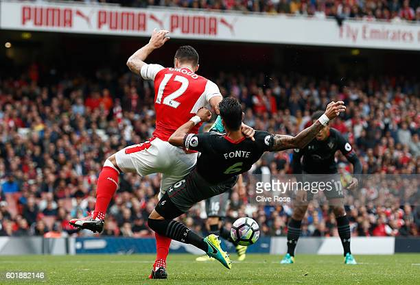 Jose Fonte of Southampton pulls Olivier Giroud of Arsenal down in the penalty area during the Premier League match between Arsenal and Southampton at...