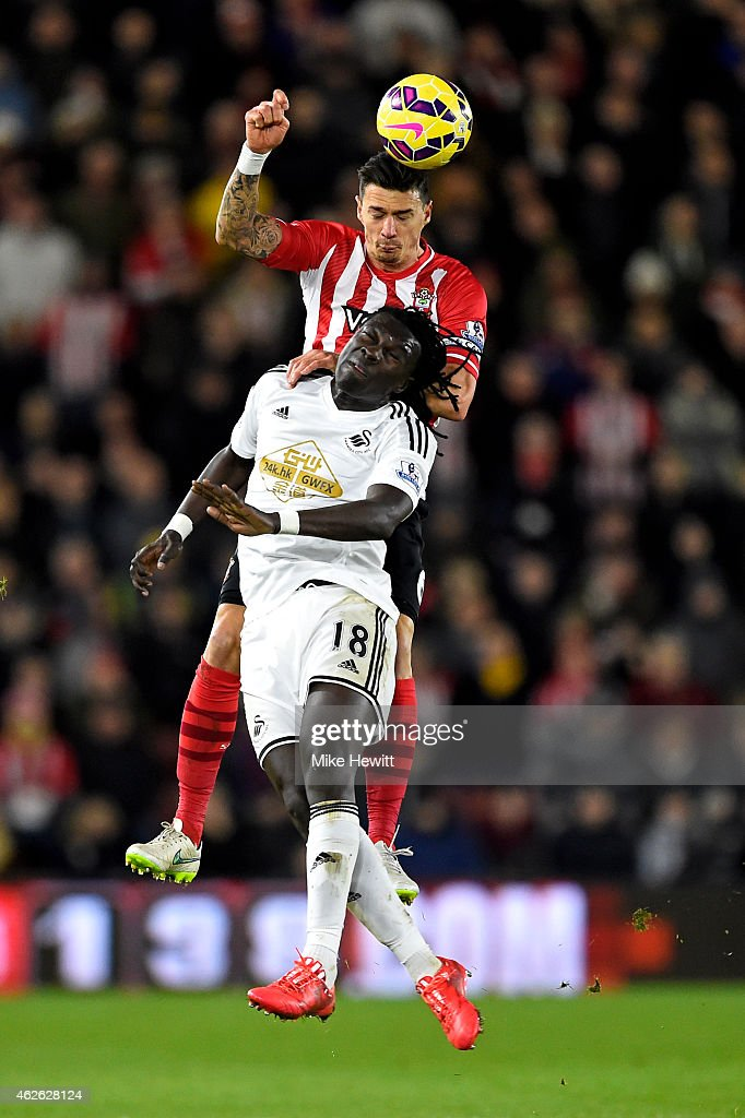 Jose Fonte of Southampton rises above Bafetibis Gomis of Swansea City to win a header during the Barclays Premier League match between Southampton and Swansea City at St Mary's Stadium on February 1, 2015 in Southampton, England.