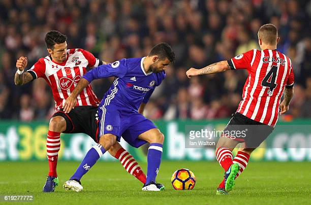 Jose Fonte of Southampton tackles Diego Costa of Chelsea during the Premier League match between Southampton and Chelsea at St Mary's Stadium on...