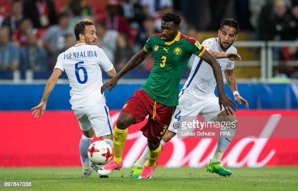Jose Fuenzalida of Chile AndreFrank Zambo Anguissa of Cameroon and Mauricio Isla of Chile fight for the ball during the FIFA Confederations Cup...