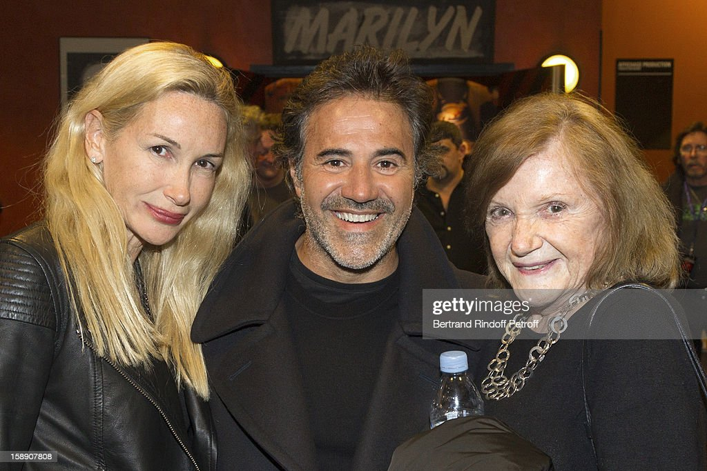 Jose Garcia (C), his wife Isabelle Doval (L) and Doval's mother pose in the dressing romms area following French impersonator Laurent Gerra's one man show at Olympia hall on December 22, 2012 in Paris, France.