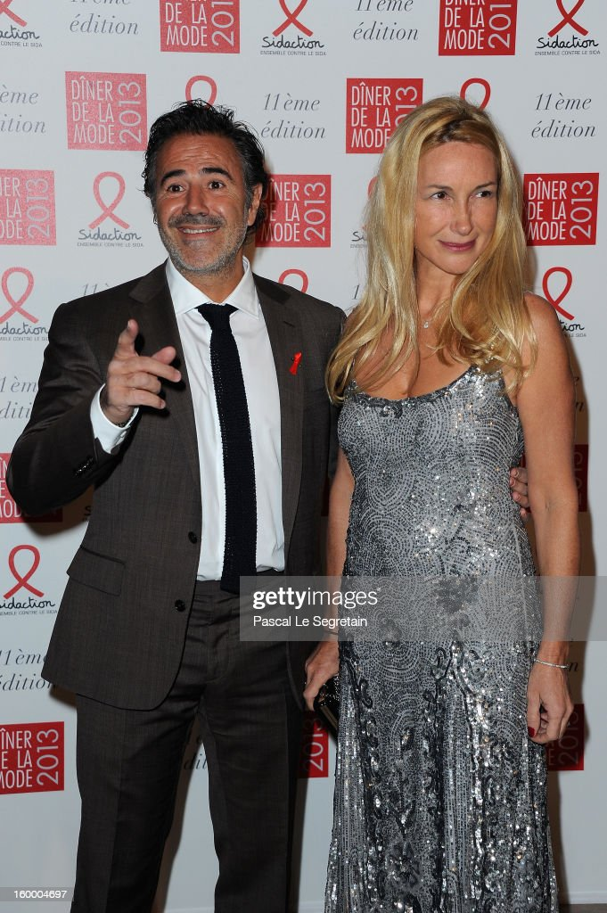 Jose Garcia; Isabelle Doval pose as they arrive to attend the Sidaction Sidaction Gala Dinner 2013 at Pavillon d'Armenonville on January 24, 2013 in Paris, France.
