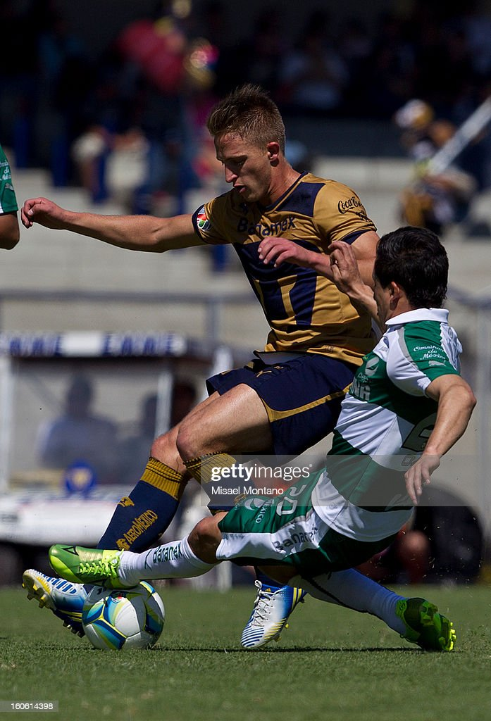 Jose Garcia of Pumas fights for the ball with Osmar Mares of Santos during a match between Pumas and Santos as part of the Clausura 2013 at Olímpico Stadium on February 03, 2013 in Mexico City, Mexico.
