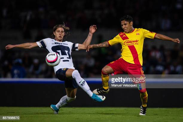 Jose Garcia of Pumas fights for the ball with Raul Ruidiaz of Morelia during the 6th round match between Pumas UNAM and Morelia as part of the Torneo...