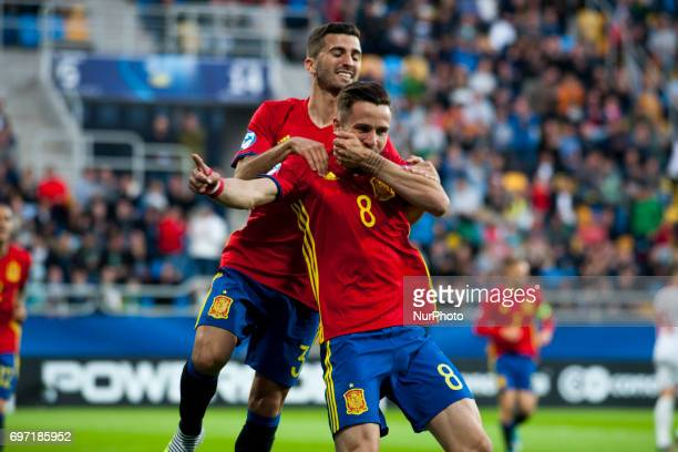 Jose Gaya and Saul Niguez of Spain celebrate after score during the UEFA Under 21 Championship Group B match between Spain and FYR Macedonia at...