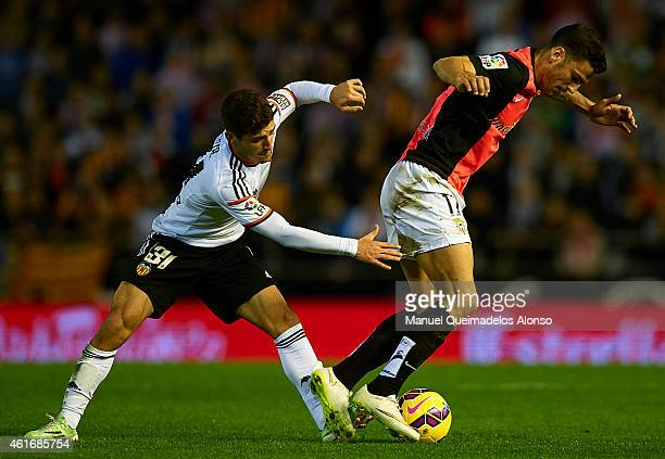 Jose Gaya of Valencia competes for the ball with Edgar Antonio Mendez of Almeria during the La Liga match between Valencia CF and UD Almeria at...