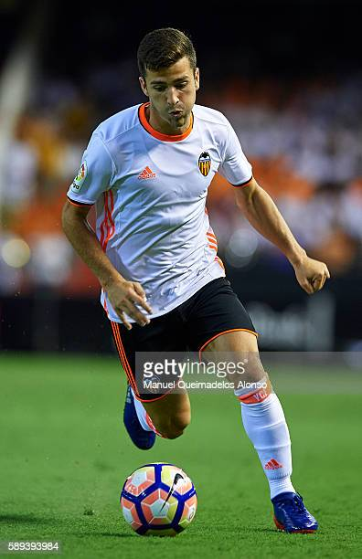 Jose Gaya of Valencia runs with the ball during the preseason friendly match between Valencia CF and AC Fiorentina at Estadio Mestalla on August 13...