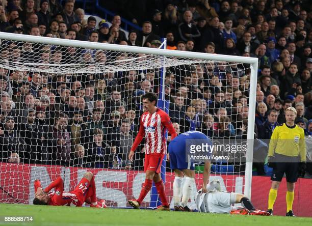 Jose Gimenez and Jan Oblak of Atletico Madrid are seen after their injury during the UEFA Champions League soccer match between Chelsea FC and...