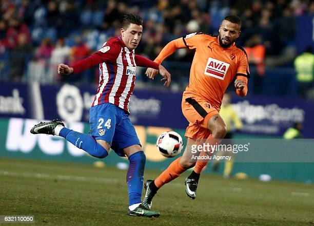 Jose Gimenez of Atletico Madrid and Bebe of Eibar vie for the ball during the King's Cup quarter final match between Atletico Madrid and Eibar at...
