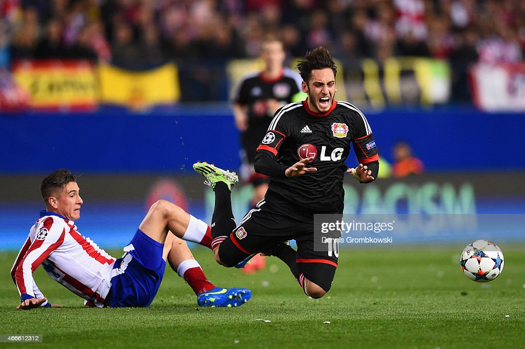 Jose Gimenez of Atletico Madrid fouls Hakan Calhanoglu of Bayer Leverkusen during the UEFA Champions League round of 16 match between Club Atletico de Madrid and Bayer 04 Leverkusen at Vicente Calderon Stadium on March 17, 2015 in Madrid, Spain.