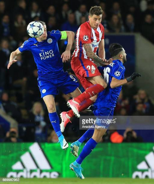 Jose Gimenez of Atletico Madrid in action against Jamie Vardy and Riyad Mahrez of Leicester City FC during the Champions League Quarter Final second...