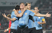 Jose Gimenez of Uruguay celebrates with team mates after scoring a goal during the international friendly match between South Korea and Uruguay at...