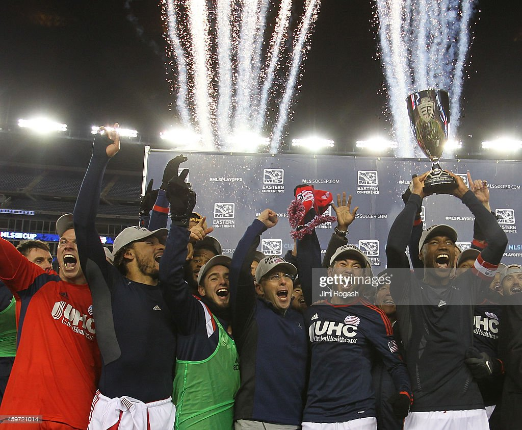 Jose Goncalves of New England Revolution holds the trophy as the team celebrates after defeating the New York Red Bulls the MLS Eastern Conference...
