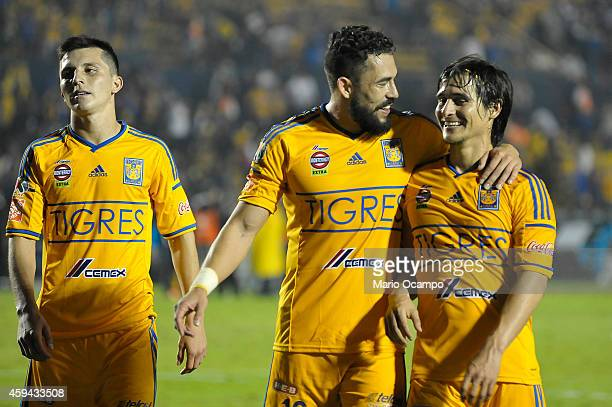 Jose 'Gringo' Torres Herculez Gomez and Jorge 'Guti' Estrada of Tigres celebrate their team's victory at the end of a match between Tigres UANL and...