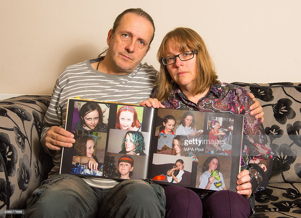 Jose Gross and Rosalind Hodgkiss, the parents of missing teenager Alice Gross hold an album of picture of their daughter at their home in Hanwell on September 25, 2014 in London, England. The hunt for Alice Gross from Hanwell, who went missing on August 28, is now being described as the largest police search operation since the 7/7 bombings of 2005. The police inquiry is now focused on a key suspect, Arnis Zalkalns, a Latvian builder, who was seen in the vicinity of Alice's last sighting.