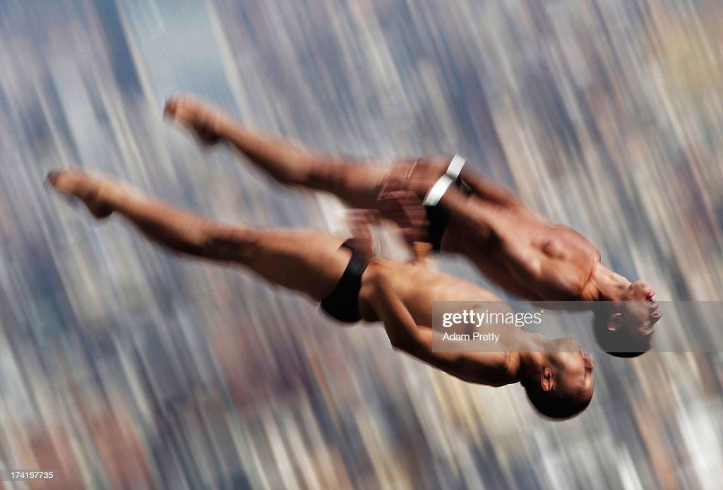 Jose Guerra Oliva and Jeinkler Aguirre Manso of Cuba compete in the Men's 10m Platform Synchronised Diving final on day two of the 15th FINA World Championships at Piscina Municipal de Montjuic on July 21, 2013 in Barcelona, Spain.