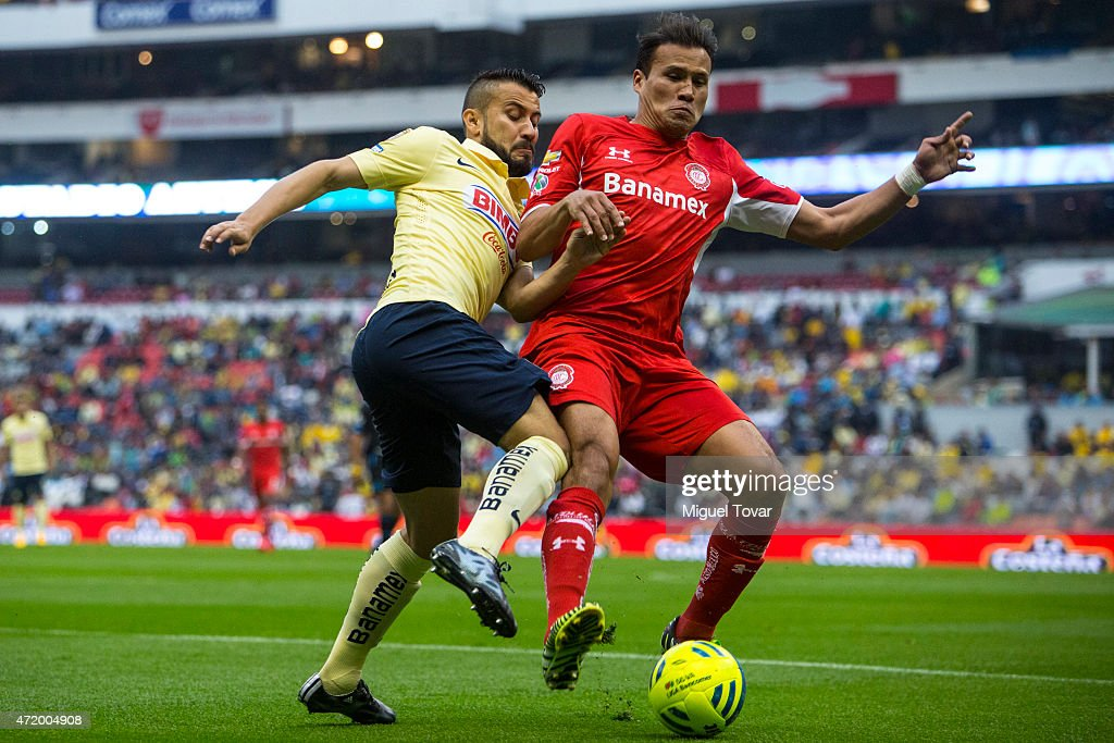 Jose Guerrero of America fights for the ball with Aaron Galindo of Toluca during a match between America and Toluca as part of 16th round of Clausura 2015 Liga MX at Azteca Stadium on May 02, 2015 in Mexico City, Mexico.