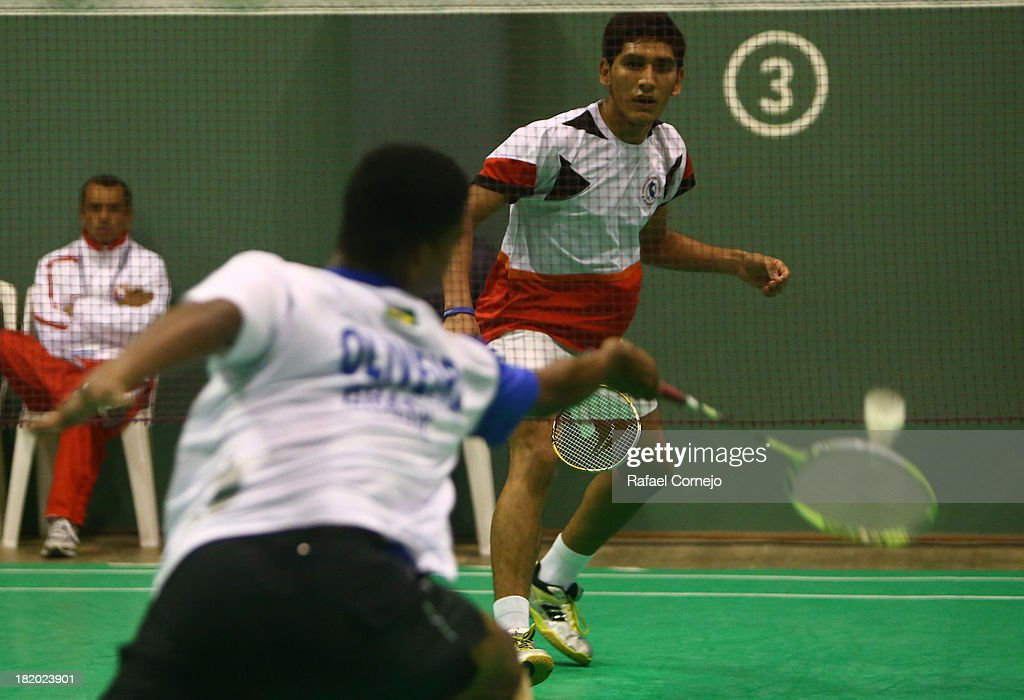 Jose Guevara of Peruœ makes a shot during his badminton men's final match as part of the I ODESUR South American Youth Games on September 27, 2013 in Lima, Peru.