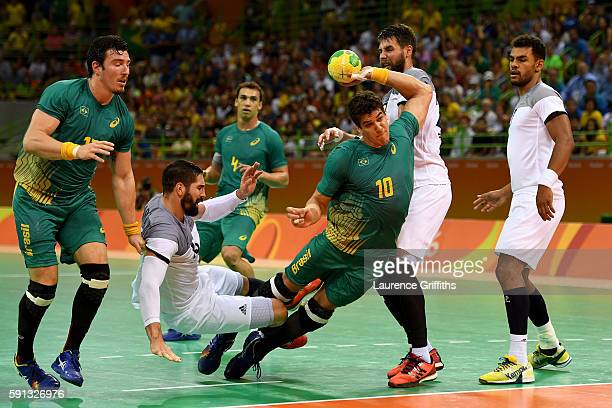 Jose Guilherme de Toledo of Brazil takes a shot during the Men's Quarterfinal Handball contest at Future Arena on Day 12 of the Rio 2016 Olympic...