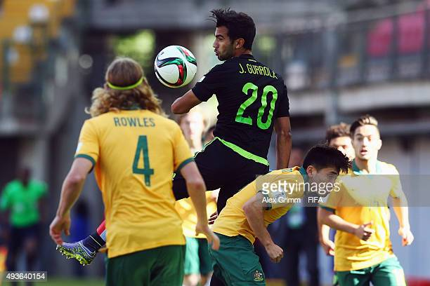 Jose Gurrola of Mexico is challenged by Joe Caletti and Kye Rowles of Australia during the FIFA U17 World Cup Chile 2015 Group C match between...