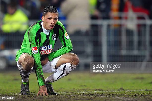 Jose Holebas of Munich sits on the pitch dejected after the Second Bundesliga match between SC Paderborn and 1860 Muenchen at Energieteam Arena on...