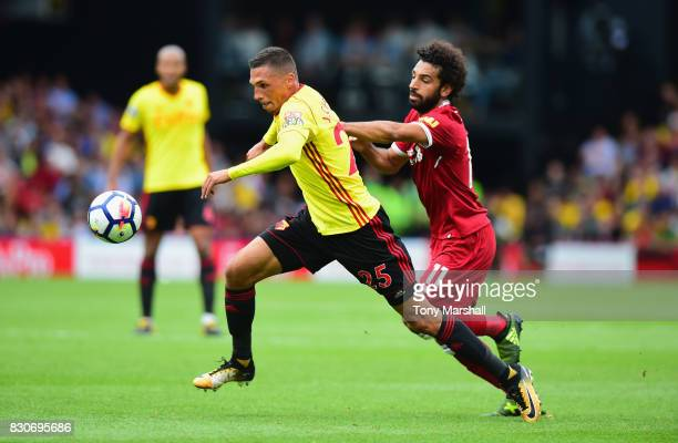 Jose Holebas of Watford and Mohamed Salah of Liverpool battle for possession during the Premier League match between Watford and Liverpool at...