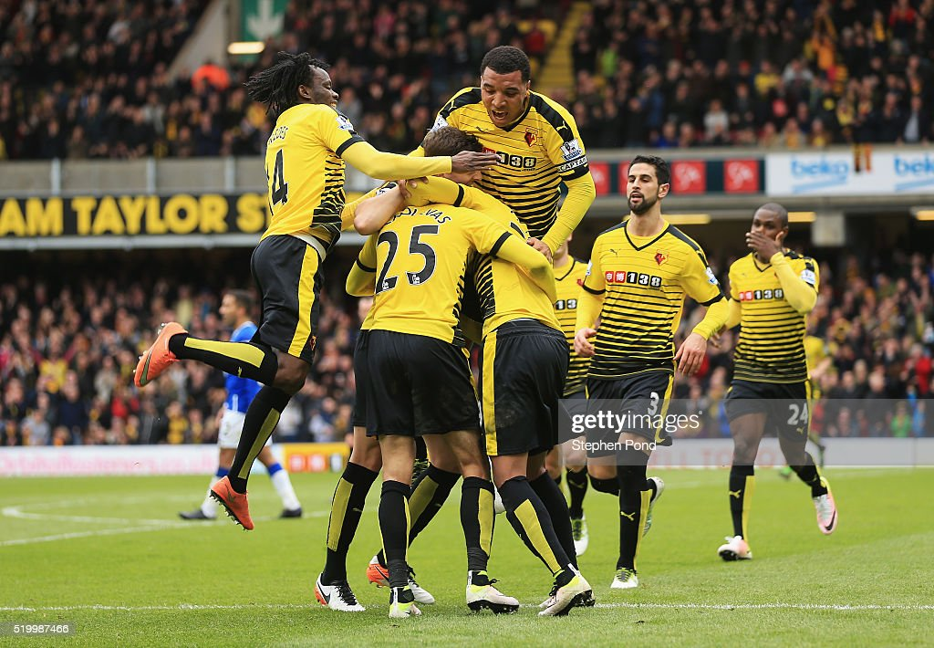 Jose Holebas of Watford celebrates scoring his team's first goal with his team mates during the Barclays Premier League match between Watford and...