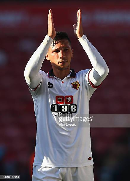 Jose Holebas of Watford celebrates victory with supporters following the full time whistle in the Premier League match between Middlesbrough and...