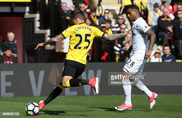 Jose Holebas of Watford is challenged by Luciano Narsingh of Swansea City during the Premier League match between Watford and Swansea City at...