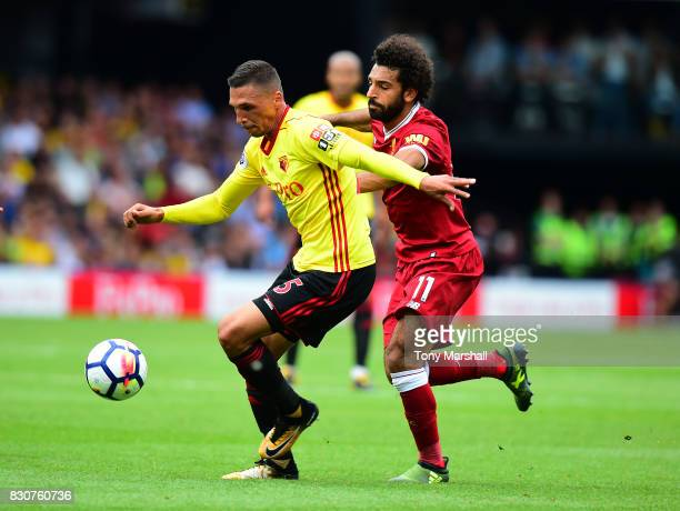 Jose Holebas of Watford is tackled by Mohamed Salah of Liverpool during the Premier League match between Watford and Liverpool at Vicarage Road on...