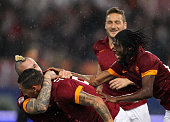 Jose Holebas with his teamamate Radja Nainggolan and Gervinho of AS Roma celebrates after scoring the second team's goal during the Serie A match...