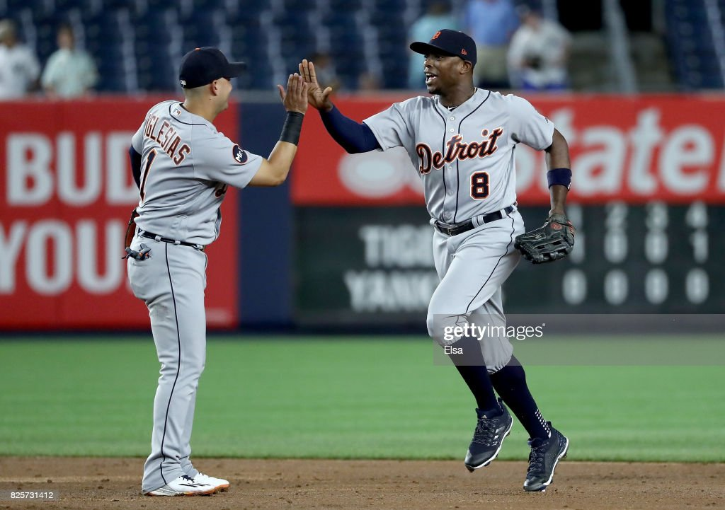 Jose Iglesias #1 and Justin Upton #8 of the Detroit Tigers celebrate the 2-0 win over the New York Yankees on August 2, 2017 at Yankee Stadium in the Bronx borough of New York City.