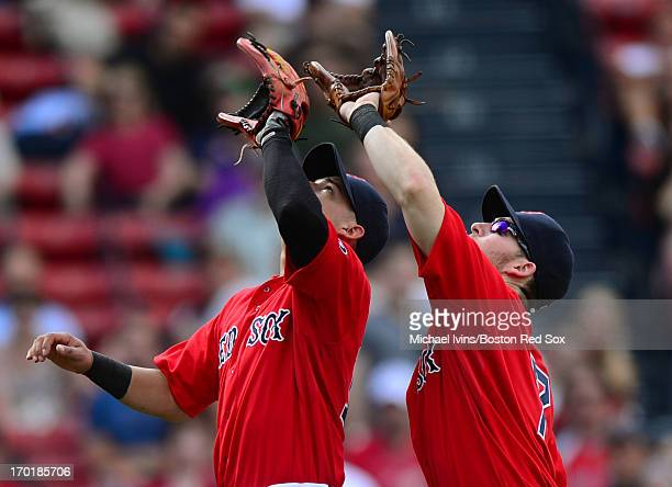 Jose Iglesias and Stephen Drew track a pop fly against the Los Angeles Angels of Anaheim in the ninth inning on June 8 2013 at Fenway Park in Boston...