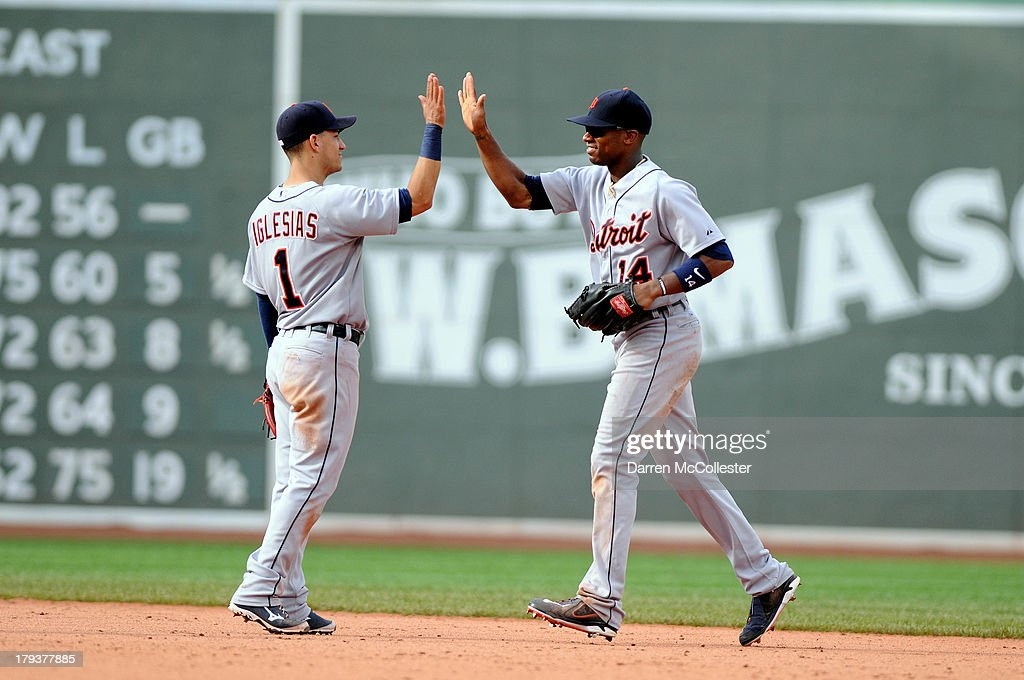 Jose Iglesias #1 congratulates teamate <a gi-track='captionPersonalityLinkClicked' href=/galleries/search?phrase=Austin+Jackson&family=editorial&specificpeople=608633 ng-click='$event.stopPropagation()'>Austin Jackson</a> #14 of the Detroit Tigers after defeating the Boston Red Sox at Fenway Park on September 2, 2013 in Boston, Massachusetts. The Tigers won the game 3-0.