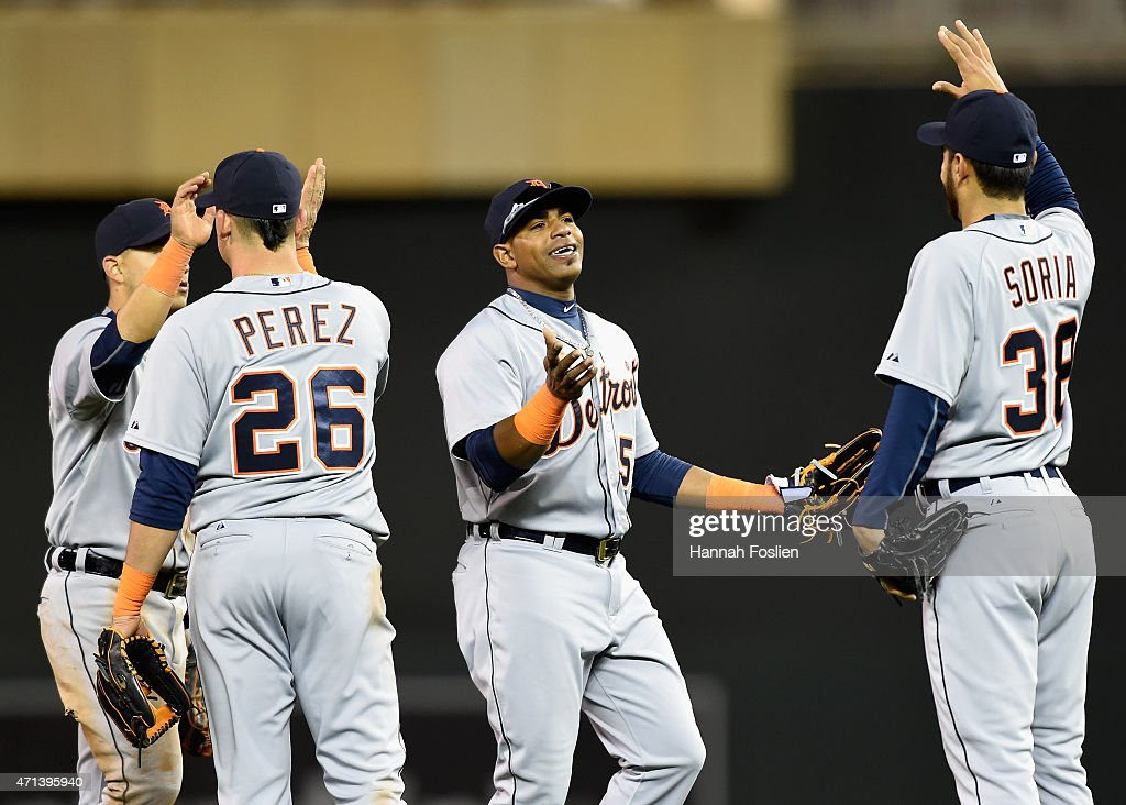 Jose Iglesias #1, Hernan Perez #26, Yoenis Cespedes #52 and Joakim Soria #38 of the Detroit Tigers celebrate a win of the game against the Minnesota Twins on April 27, 2015 at Target Field in Minneapolis, Minnesota. The Tigers defeated the Twins 5-4.