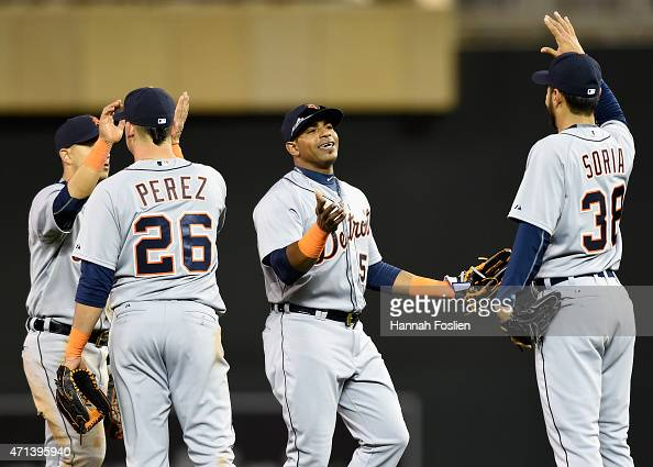 Jose Iglesias Hernan Perez Yoenis Cespedes and Joakim Soria of the Detroit Tigers celebrate a win of the game against the Minnesota Twins on April 27...