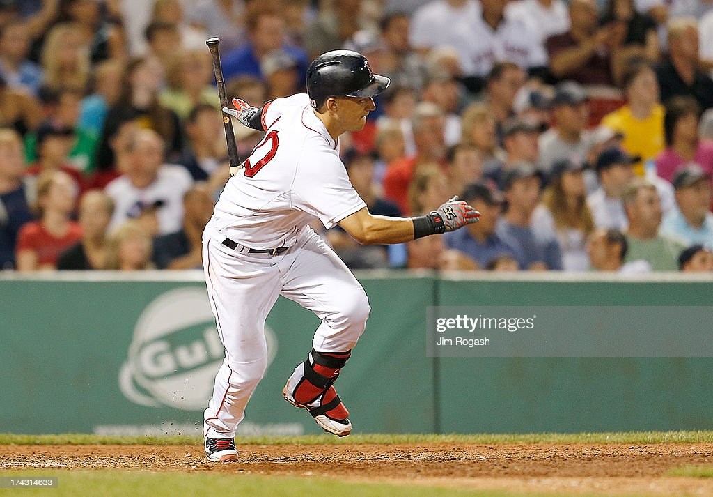Jose Iglesias #10 of the Boston Red Sox singles in two-run in the 8th inning against the Boston Red Sox at Fenway Park on July 23, 2013 in Boston, Massachusetts.