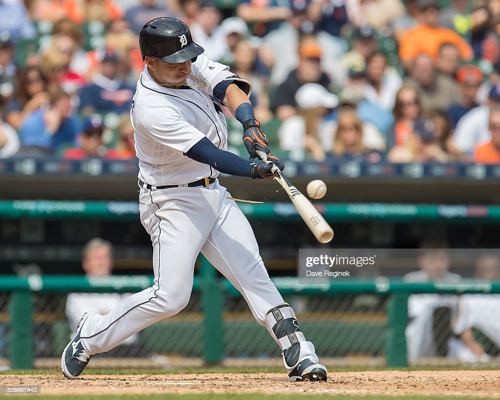 Jose Iglesias #1 of the Detroit Tigers breaks his bat on a pitch in the eighth inning during a MLB game against the Texas Rangers at Comerica Park on May 7, 2016 in Detroit, Michigan. The Rangers defeated the Tigers 10-5.