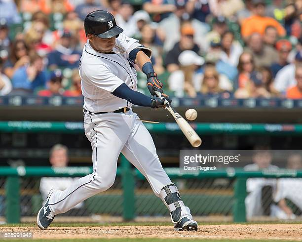 Jose Iglesias of the Detroit Tigers breaks his bat on a pitch in the eighth inning during a MLB game against the Texas Rangers at Comerica Park on...