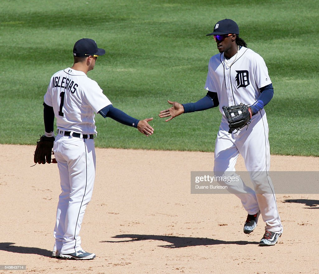 Jose Iglesias #1 of the Detroit Tigers celebrates with <a gi-track='captionPersonalityLinkClicked' href=/galleries/search?phrase=Cameron+Maybin&family=editorial&specificpeople=2364846 ng-click='$event.stopPropagation()'>Cameron Maybin</a> #4 of the Detroit Tigers after a 10-3 win over the Miami Marlins at Comerica Park on June 29, 2016 in Detroit, Michigan.