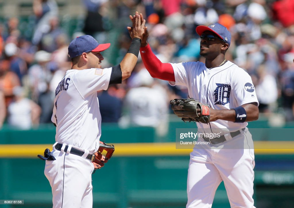 Jose Iglesias #1 of the Detroit Tigers celebrates with Justin Upton #8 of the Detroit Tigers after a 5-3 win over the San Francisco Giants at Comerica Park on July 4, 2017 in Detroit, Michigan.