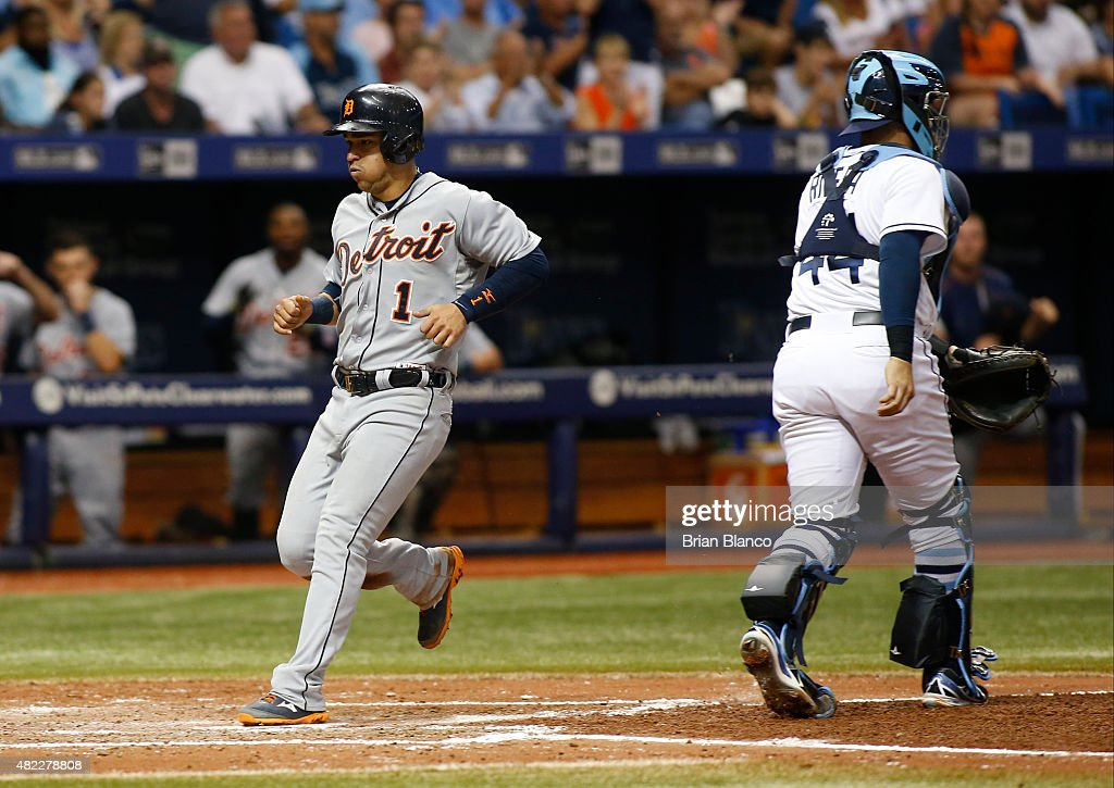 Jose Iglesias #1 of the Detroit Tigers crosses home plate ahead of catcher <a gi-track='captionPersonalityLinkClicked' href=/galleries/search?phrase=Rene+Rivera&family=editorial&specificpeople=234850 ng-click='$event.stopPropagation()'>Rene Rivera</a> #44 of the Tampa Bay Rays to score off of an RBI single by J.D. Martinez #28 during the seventh inning of a game on July 29, 2015 at Tropicana Field in St. Petersburg, Florida.
