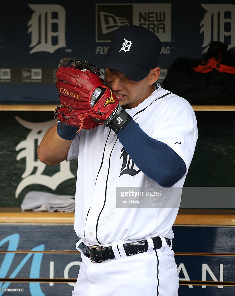 Jose Iglesias #1 of the Detroit Tigers gets his glove ready prior to the start of the game against the Chicago White Sox at Comerica Park on August 2, 2013 in Detroit, Michigan.