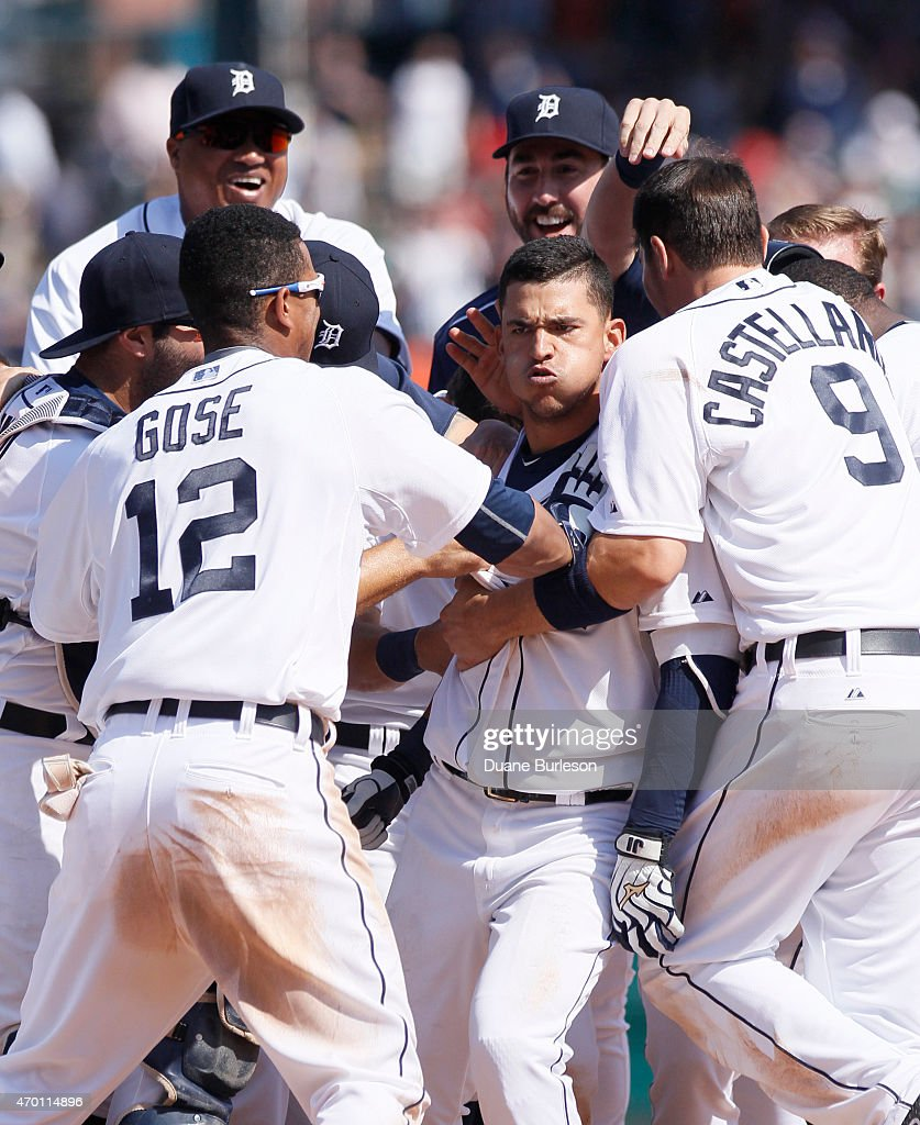 Jose Iglesias #1 of the Detroit Tigers is surrounded by teammates, including Anthony Gose #12 and Nick Castellanos #9, after hitting a game-winning RBI-single to defeat the Chicago White Sox 2-1at Comerica Park on April 17, 2015 in Detroit, Michigan.