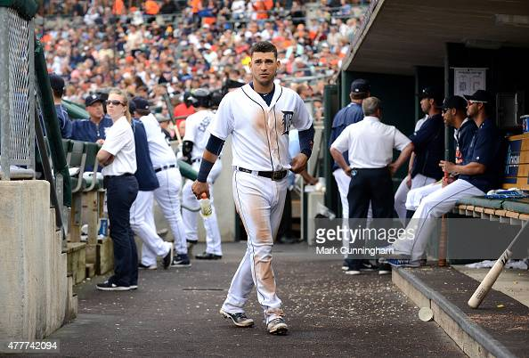 Jose Iglesias of the Detroit Tigers looks on from the dugout during the game against the Cleveland Indians at Comerica Park on June 13 2015 in...