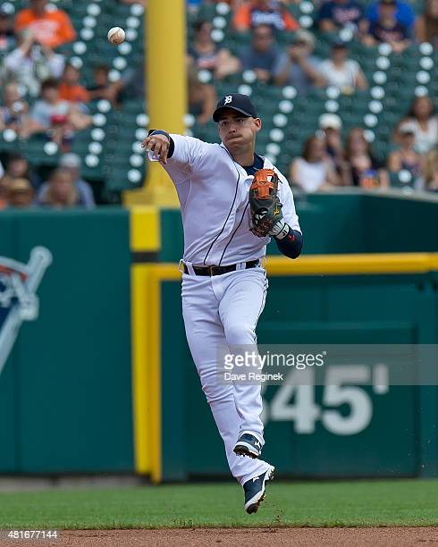 Jose Iglesias of the Detroit Tigers makes a play to first base against the Seattle Mariners at Comerica Park on July 23 2015 in Detroit Michigan