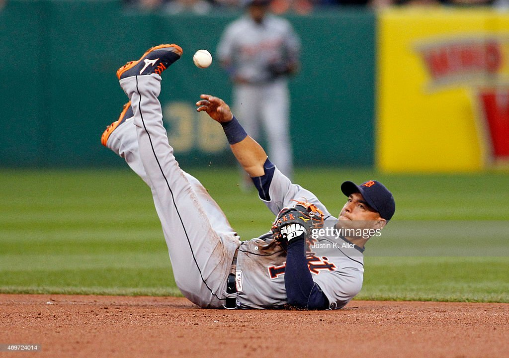 Jose Iglesias #1 of the Detroit Tigers makes a throw from his back in the second inning during interleague play against the Pittsburgh Pirates at PNC Park on April 14, 2015 in Pittsburgh, Pennsylvania.