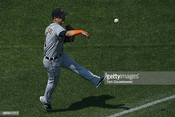 Jose Iglesias of the Detroit Tigers makes the play and throws out the baserunner in the third inning during MLB game action against the Toronto Blue...