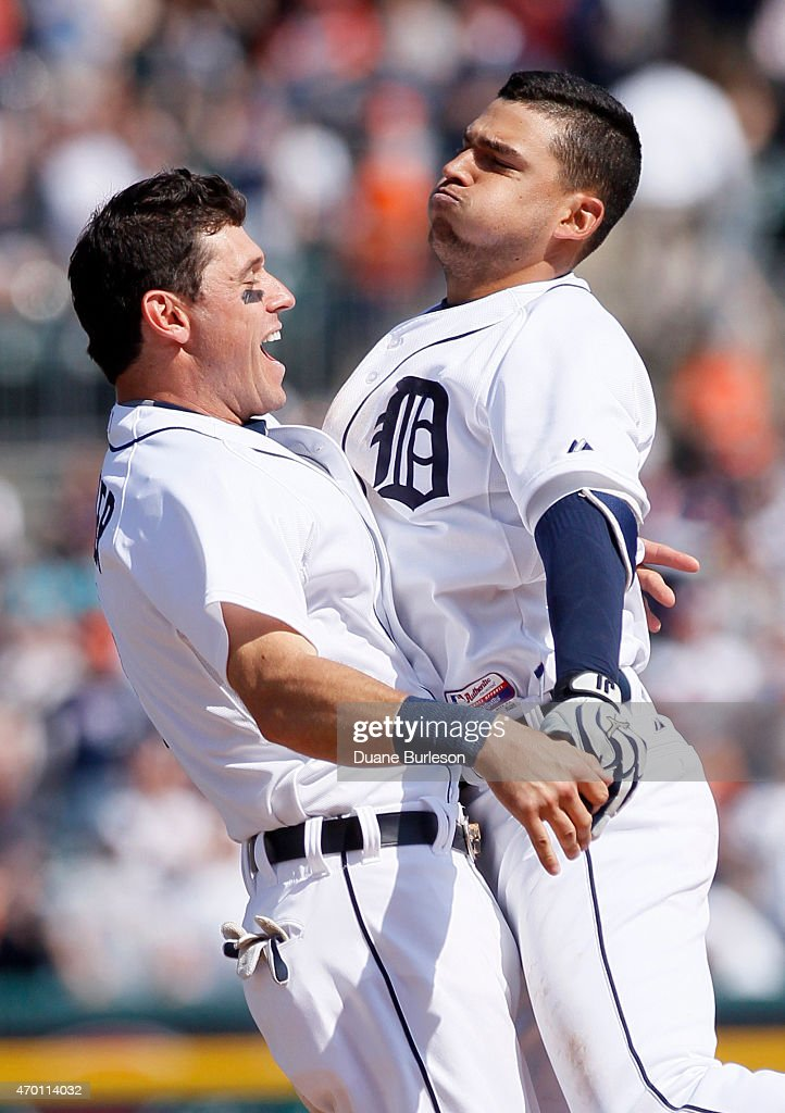Jose Iglesias #1 of the Detroit Tigers, right, chest-bumps <a gi-track='captionPersonalityLinkClicked' href=/galleries/search?phrase=Ian+Kinsler&family=editorial&specificpeople=538104 ng-click='$event.stopPropagation()'>Ian Kinsler</a> #3 of the Detroit Tigers after hitting an RBI-single to defeated the Chicago White Sox 2-1 in the ninth inning at Comerica Park on April 17, 2015 in Detroit, Michigan.